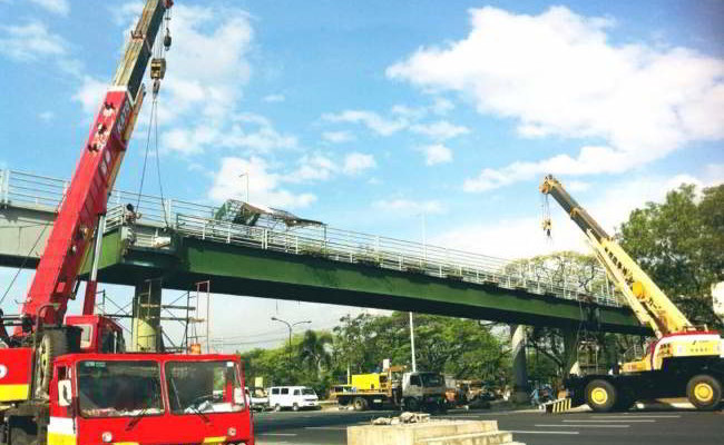 Lifting of Pedestrian Overpass in Commonwealth